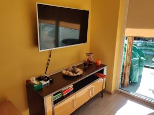 A television and/or entertainment centre at Sunny Apartment