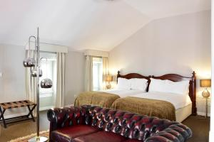 A bed or beds in a room at Palacete Chafariz Del Rei - member of Unlock Hotels