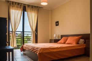 A bed or beds in a room at Apartamentos Sotavento - Playa La Tejita - El Médano