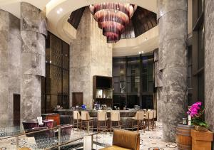 A restaurant or other place to eat at Carlton City Hotel Singapore (SG Clean)