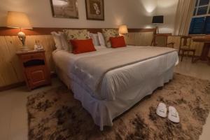 Cama ou camas em um quarto em Quinta da Paz Resort
