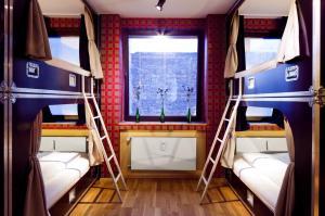 A bunk bed or bunk beds in a room at Hostel die Wohngemeinschaft