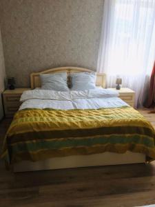 Кровать или кровати в номере Tbili Sakhli Guest House