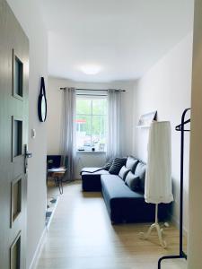 A seating area at Niron Apartament