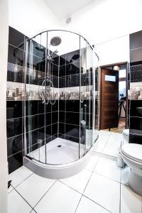 Łazienka w obiekcie Apartamenty Grunwaldzkie