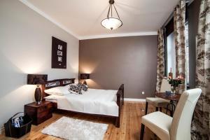 Łóżko lub łóżka w pokoju w obiekcie Apartamenty Grunwaldzkie