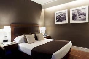 מיטה או מיטות בחדר ב-Royal Ramblas