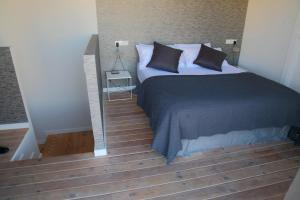 Cama o camas de una habitación en Apartamentos Alfonso X