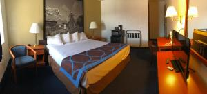A bed or beds in a room at Super 8 by Wyndham Montgomery Maybrook
