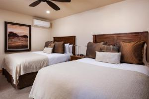 A bed or beds in a room at The Gant