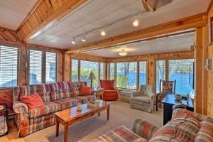 A seating area at Waterfront Home on Lake George with Boat Dock!
