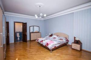 Cama ou camas em um quarto em Apartment in the city center by Time Group