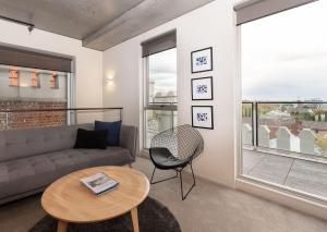 A seating area at Luxury East Melbourne Apartment