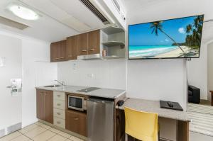 A kitchen or kitchenette at Waters Edge The Strand