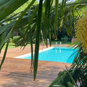 The swimming pool at or near B&B La Laiterie de Fontpatour