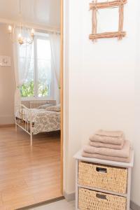 Un ou plusieurs lits dans un hébergement de l'établissement La Fée Maison