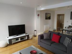 A television and/or entertainment center at RiiS Apartments Camberley