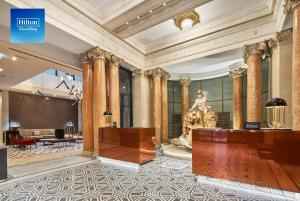 The lobby or reception area at DoubleTree By Hilton Trieste