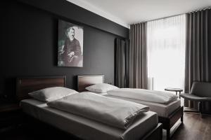 A bed or beds in a room at GRONERS Leipzig