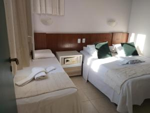 A bed or beds in a room at Hotel Pousada da Mangueira
