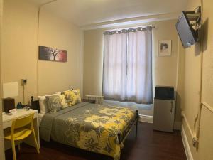 A bed or beds in a room at Orange Village Hostel