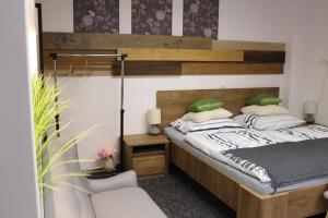 A bed or beds in a room at Apartmány Caffe & Grill