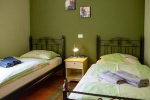 Postelja oz. postelje v sobi nastanitve Rooms Herman