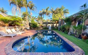 The swimming pool at or near Coastal Waters Motor Inn