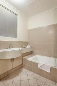A bathroom at Best Western Northbridge Apartments