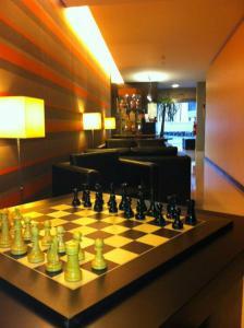 A área de bar ou lounge em Hotel do Terco