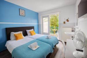 Een bed of bedden in een kamer bij Lightotel Eindhoven