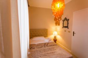 Кровать или кровати в номере 1920 Music Hotel