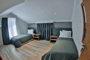 Cama ou camas em um quarto em Yurd Hotel