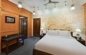 A bed or beds in a room at Pearl Palace Heritage Boutique Hotel