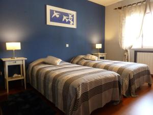 A bed or beds in a room at B&B Casa Nostra