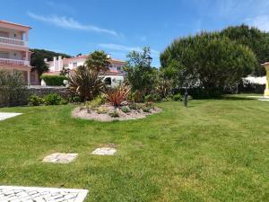 A garden outside Apartment Beach Pool Golf Silver Coast H4U