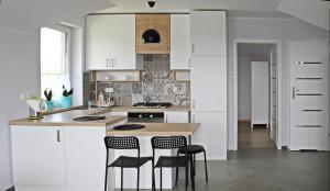 Kuchnia lub aneks kuchenny w obiekcie HOSTE Apartamenty na wczasy