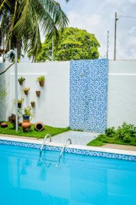 The swimming pool at or near Hotel Recanto da Costeira