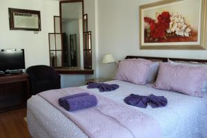 A bed or beds in a room at Caravelle Palace Hotel