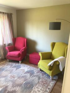 Ein Sitzbereich in der Unterkunft Haus 1