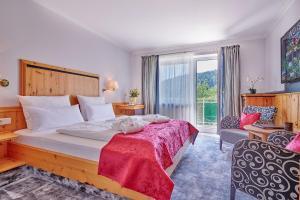 Ein Bett oder Betten in einem Zimmer der Unterkunft Hotel Reinerhof