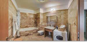 A bathroom at Avantgarde Apartments