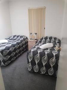 A bed or beds in a room at Bayview Apartments