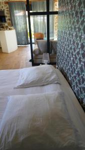 Un ou plusieurs lits dans un hébergement de l'établissement La Chomotte