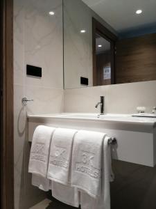 Uma casa de banho em Hotel 3K Faro Aeroporto