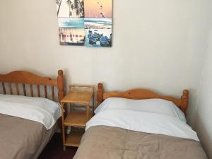 A bed or beds in a room at Pantyrathro International Hostel