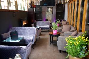 A seating area at Karma Sanctum Soho Hotel