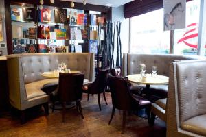 A restaurant or other place to eat at Karma Sanctum Soho Hotel