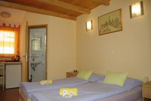 Letto o letti in una camera di Apartments & Rooms BARBARA