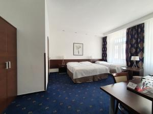 A bed or beds in a room at Royal Plaza